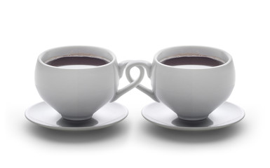 two coffee cups with braided handles