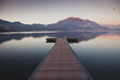 a long pier leading out onto the lake, sunrise on lake, long way