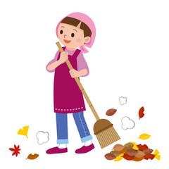 落ち葉掃きをする主婦