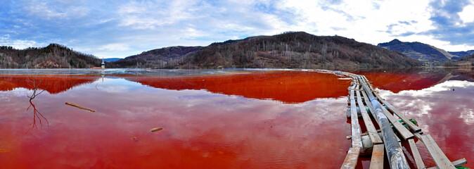 Environmental disaster. Lake full with contaminate red water