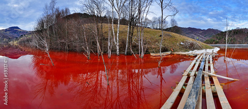 Environmental disaster. Lake full with contaminate red water