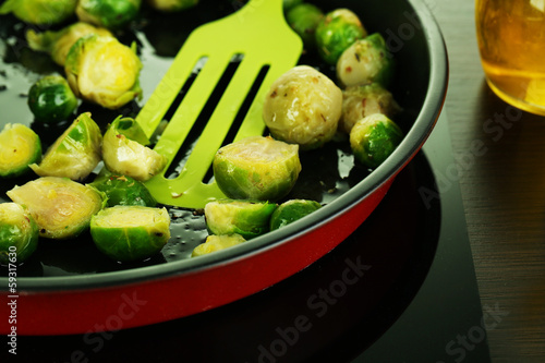 Fresh brussels sprouts in pan on cooking surface close-up