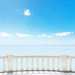white balcony on terrace near sea and blue sky