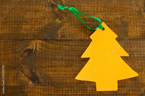 Orange label on wooden background