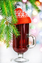Christmas mulled wine in the glass with red hat