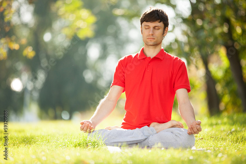 Man doing yoga exercises in the park