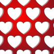вырезанные сердца на красном фоне