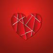 разбитое сердце на красном фоне