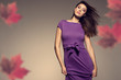 autumn portrait of beautiful woman wearing purple dress