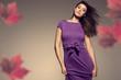 autumn portrait of beautiful woman wearing purple dress