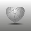 осколки серого сердца на сером фоне