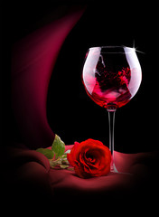 wine glass on black and red silk