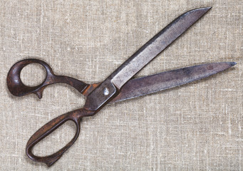 old tailor shears on textile
