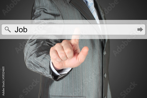 Businessman pushing virtual search bar with job word