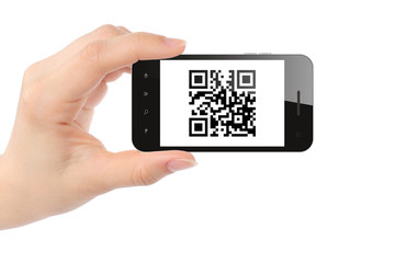 Hand holds smart phone with QR code on white background .