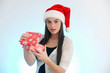 Beautiful girl with Santa hat and gift