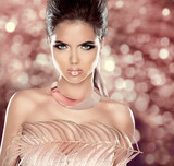 Glamour Fashion Woman Portrait with Luxury Jewelry. Hairstyle. V