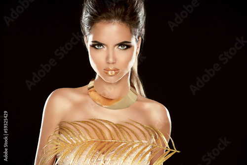 Glamour Fashion Girl Model Portrait with Luxury Golden Jewelry.