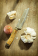 Garlic and shallot with knife