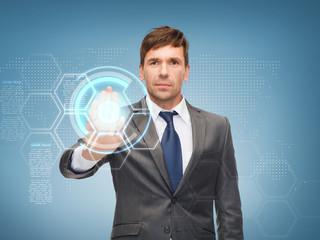 attractive buisnessman working with virtual screen