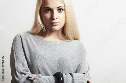 Beautiful blond woman in dress.fashion model girl.modest