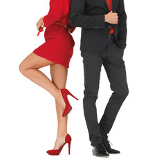 man in suit and woman in red dress