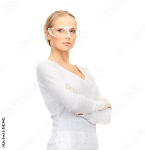 woman in protective glasses and gloves