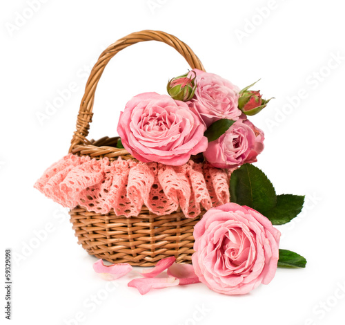 Pink roses in a wicker basket with lace