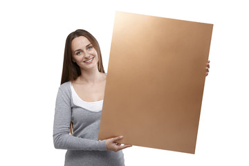 Woman holding golden billboard