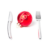 Christmas ball on table with a fork and knife
