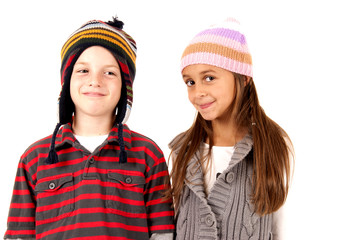 young boy and girl wearing winter hats