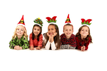 five children in silly christmas hats laying down