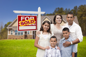 Hispanic Family, New Home and Sold Real Estate Sign