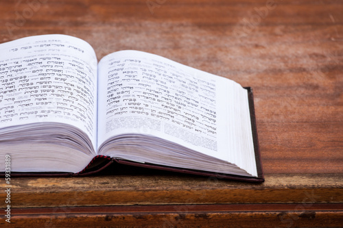Jewish praying book on table.