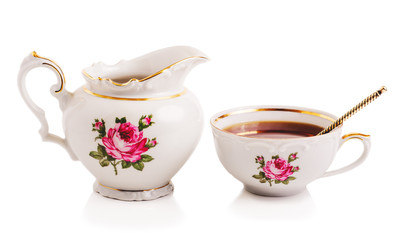 Modern porcelain teapot and cup on the white isolated backgrond