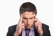 Tensed businessman suffering from headache