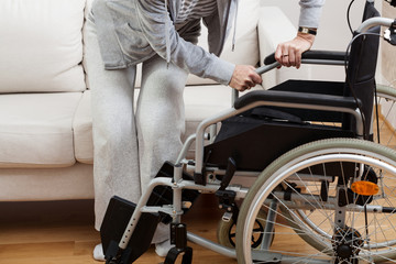 Sitting down on wheelchair