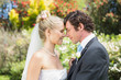 Pretty wife touching noses with new husband