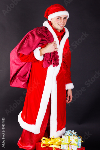 Young man wearing like Santa clause. Christmas