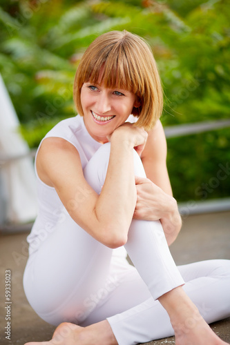 Middleaged woman make a break of her workout
