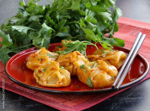 Chinese dumplings - dim sum with sour-sweet sauce