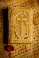 Old prayer book on antique letters