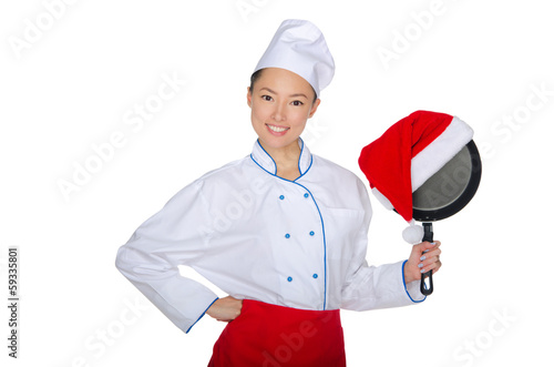 Asian chef and a frying pan in Santa hat