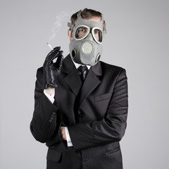Man in a gas mask with a cigarette