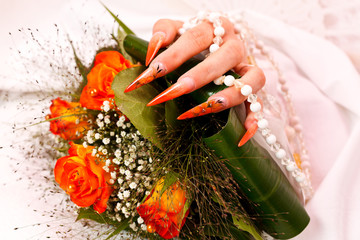 Long orange artificial bridal nails