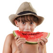Pretty brown-eyed girl eating ripe watermelon