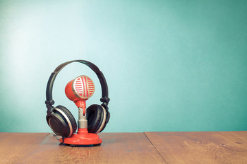 Red microphone and headphones front mint green background