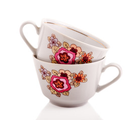 Porcelain retro cup in a white solated background