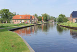 Canal with houses near Giethoorn, the Netherlands