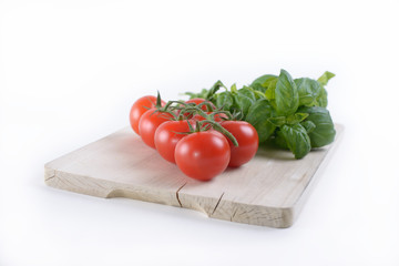 A board with tomato and basil